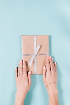 Female hands holding a box with gift