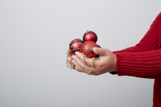 Female hands holding a christmas ball