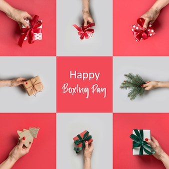 Female hands holding different gifts on grey and red. xmas greeting card. boxing day.