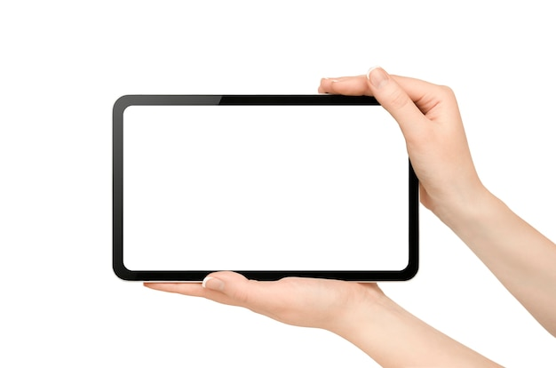 Female hands holding digital tablet on isolated white wall