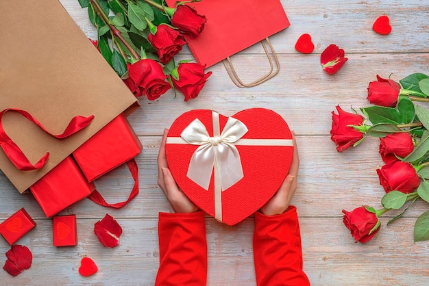 Female hands holding heart shaped boxes lovers valentines day