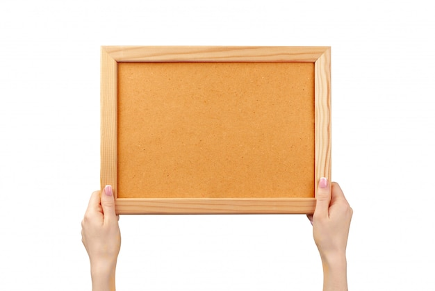 Female hands holding photo frame with copy space isolated on white