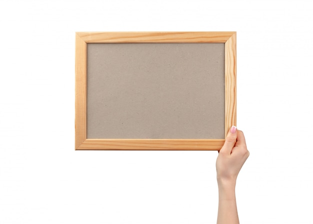 Female hands holding photo frame with copy space isolated