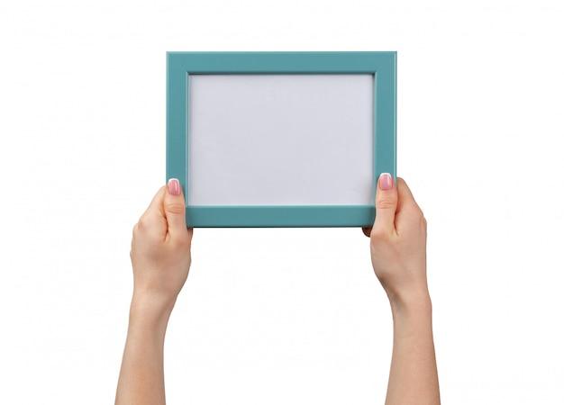 Female hands holding photo frame