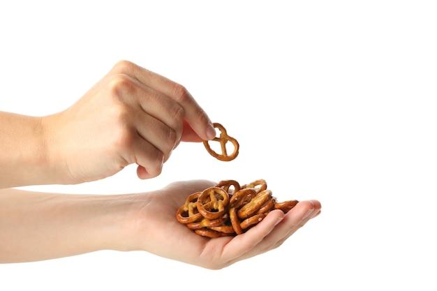 Female hands holds cracker pretzels, isolated on white
