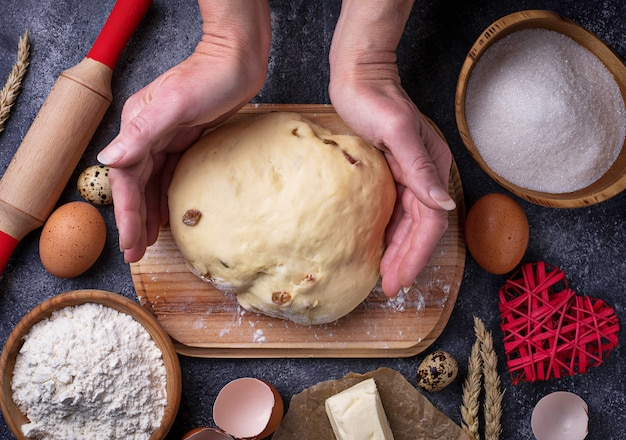 Female hands knead the dough. backing concept. top view