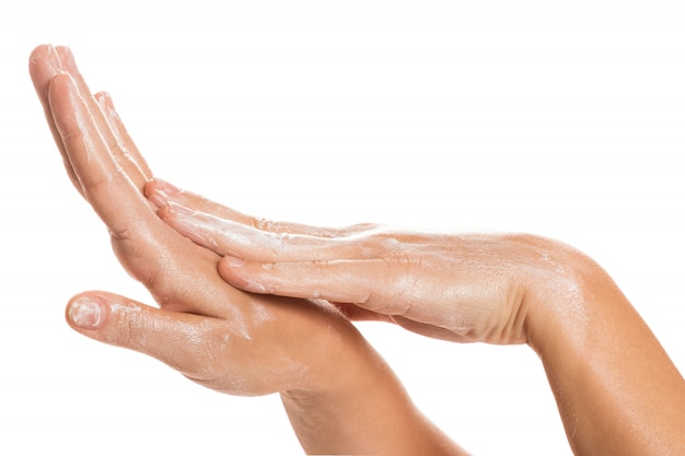 Female hands and moisturizing cream
