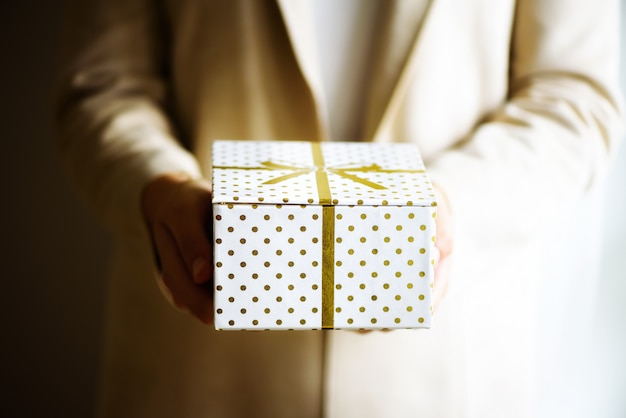 Female hands opening gift box, copy space. christmas, hew year, birthday concept. banner