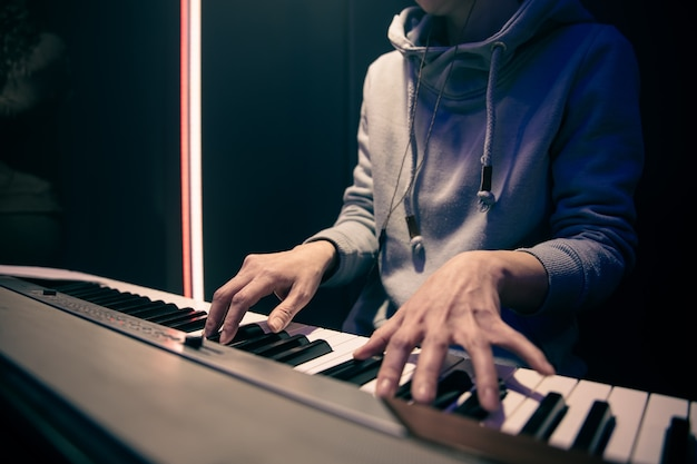 Female hands play the piano