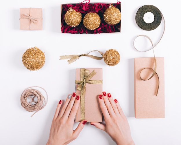 Female hands prepare christmas decorations