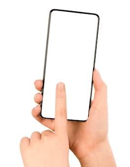 女性の手は、孤立した白い背景の上の空白のスマートフォン画面を押す