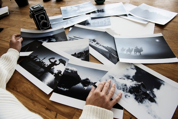 Female hands selecting photos