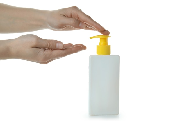여성의 손을 흰색 격리 된 배경에 고립 된 자외선 차단제를 좋다고