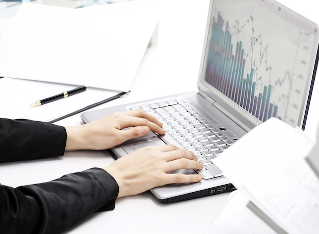 Female hands typing on the keyboard and while holding the mouse.