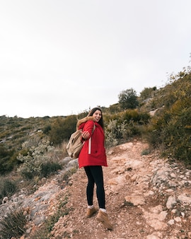 A female hiker with her backpack walking on mountain trail