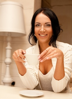 Female holding a mug of coffee