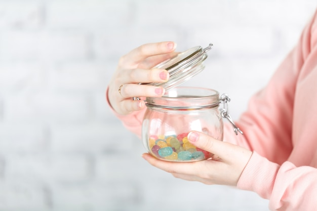 Female holg glass jar with jelly