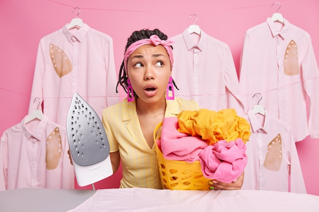 Female housekeeper does household chores