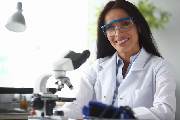 Female indian chemist look at camera against chemistry lab