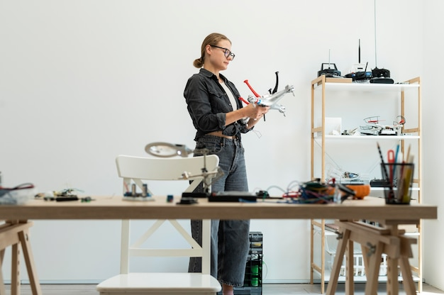 Female inventor working at a new creation