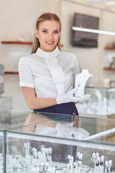 Female jeweler at her store