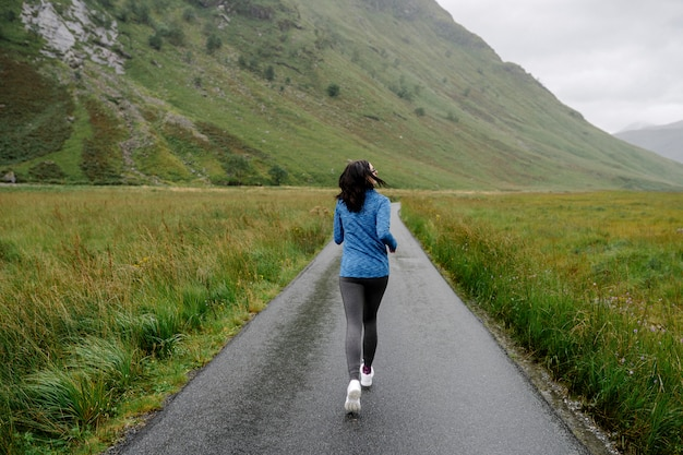 Female jogger in the highlands