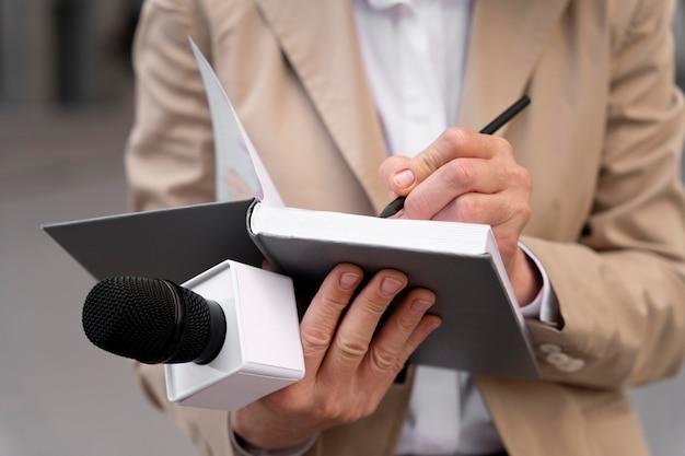 Female journalist taking notes