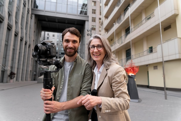 Female journalist with her cameraman