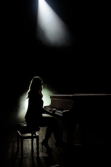 Female keyboards player on stage during concert