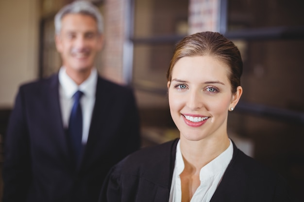 Female lawyer smiling while male colleague