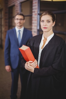 Female lawyer with businessman standing