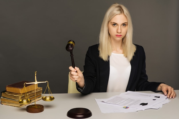 Female lawyer working at table in office - image