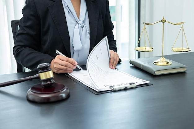 Female lawyer working with legal case document contract in office, law and justice, attorney, lawsuit concept.