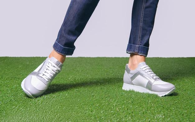 Female legs in comfort casual urban sneakers.