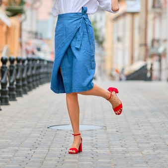 Female legs in jeans wrap skirt