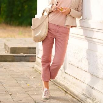 Female legs in linen trousers.