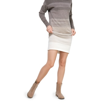 Female legs in shoes with lifted skirt, knitted clothes.