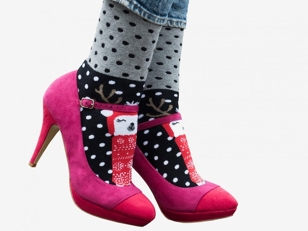 Female legs in stylish shoes, bright, variegated socks