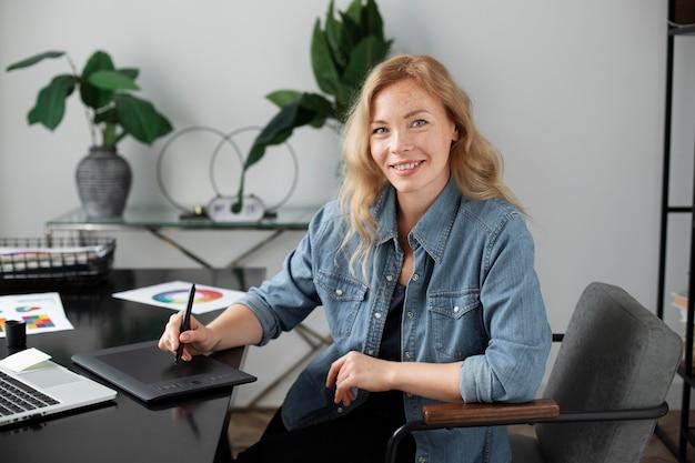 Female logo designer working on a graphic tablet