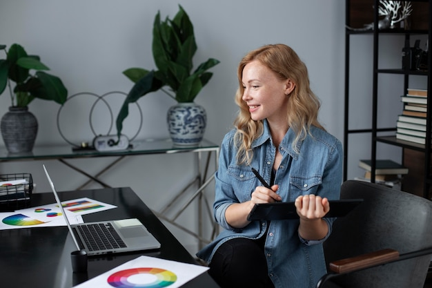 Female logo designer working at her office on a graphic tablet
