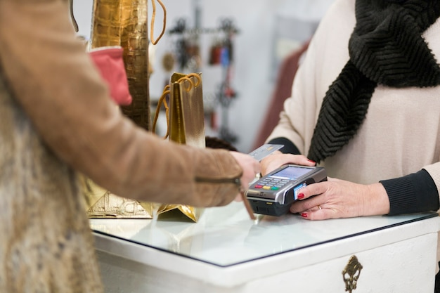 Female making purchase with credit card