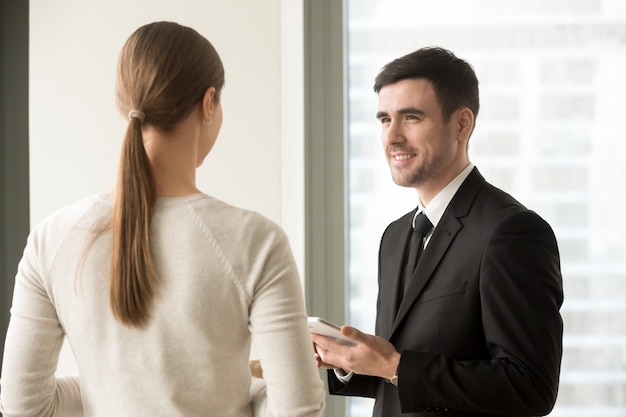 Female and male colleagues meeting in office