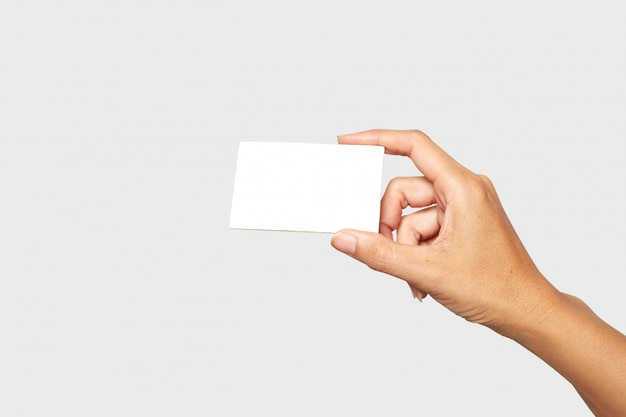 Female or male hand holding blank card on white