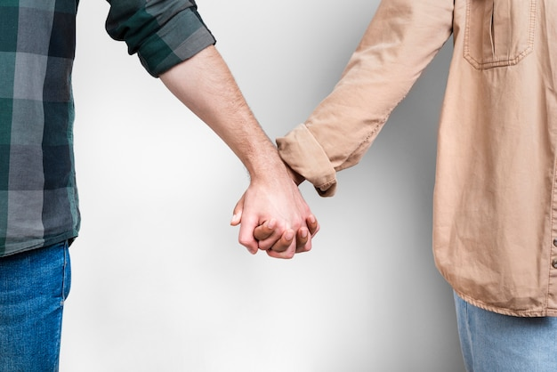 Female and male hand holding together