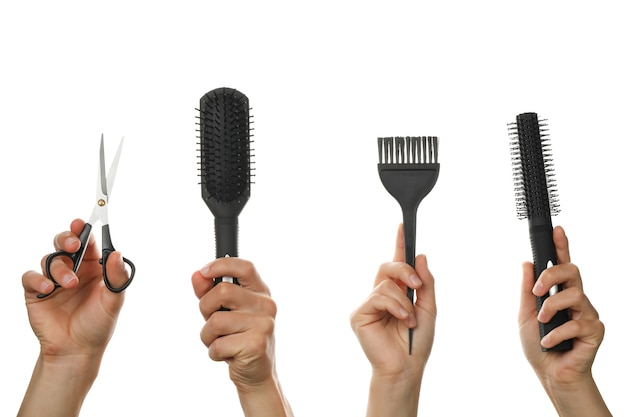 Female and male hands hold hairdressing tools, isolated