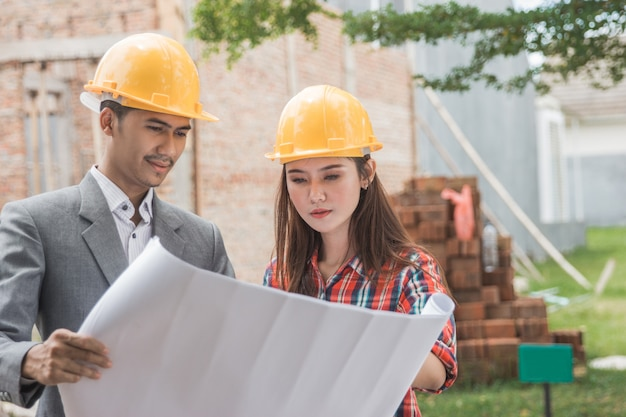 Female and male house building designers