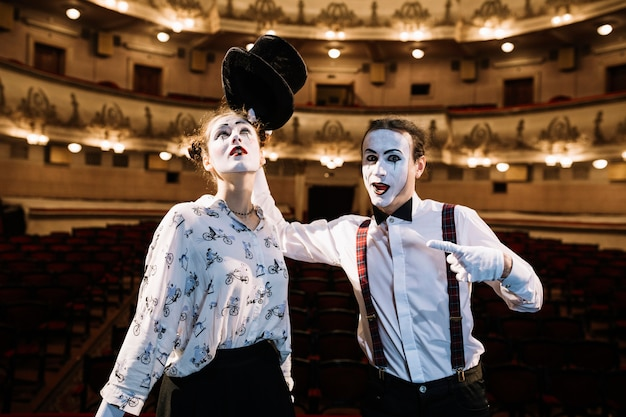 Female and male mime artist performing on stage