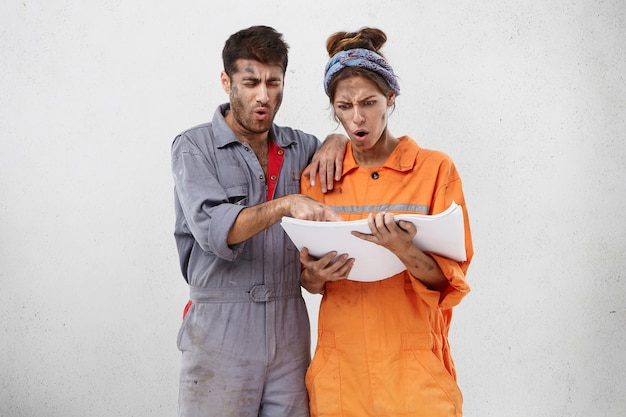 Female and male workers wearing work clothes