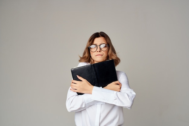 Female manager with folder for papers professional light background