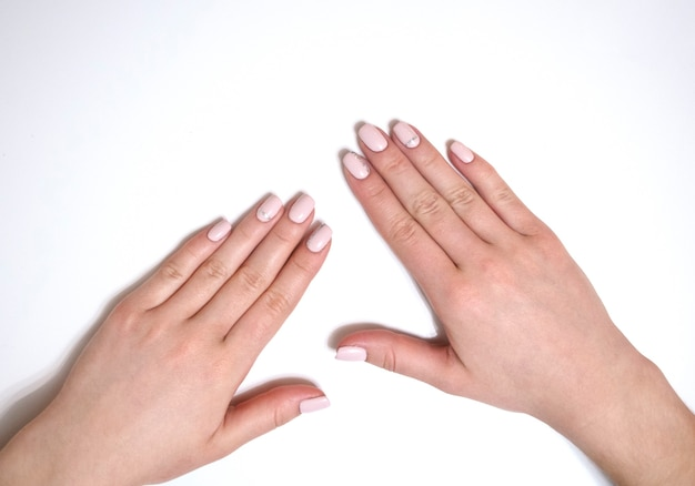 Female manicure on a white background. simple manicure for a girl. banner.